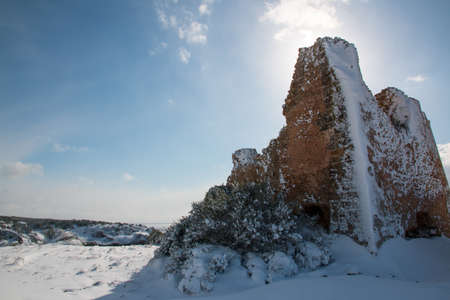 Uluzzo tower after snowfall in exceptional, Salento, Italy. Stock Photo