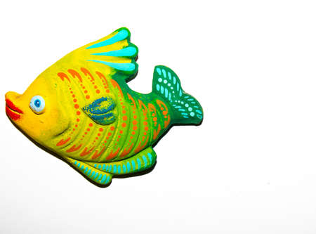 Toy fish on white background