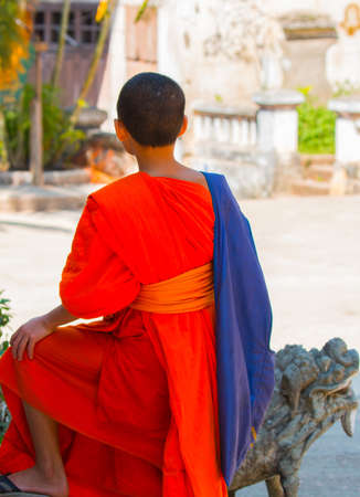 Novice monk with colored tunic, Lao