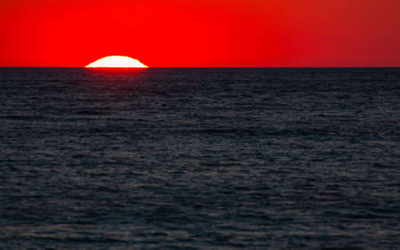 Ionian sea , red sunset, Salento, Italy Banque d'images