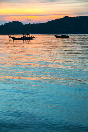 Fishermen boat at sunset near Koh Phangan island, Thailand