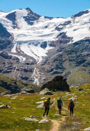 Mountaineers walking to Forni glacier, Stelvio National Park, Italy Stock Photo