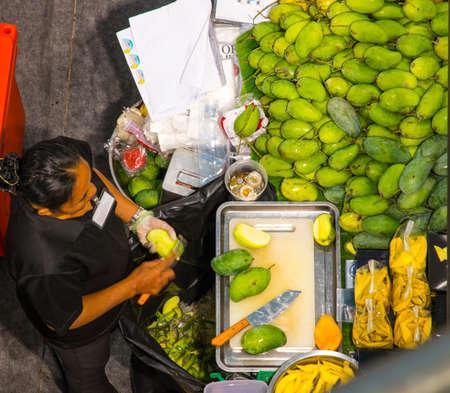 mango seller in Bangkok, Thailand Editorial