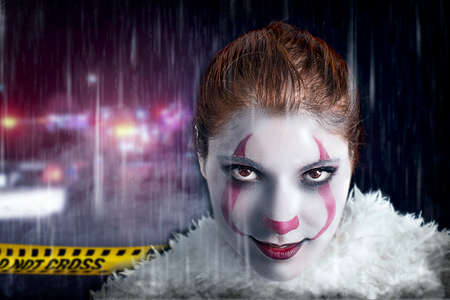 Evil clown on a crime scene Stock Photo