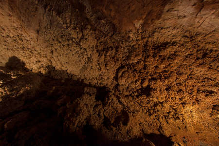 Underground shot inside a natural cave, no people are visible