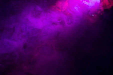 Abstract with coloured smoke on black background.