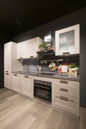 Wide angle view of a modern kitchen interior, no people are visible.