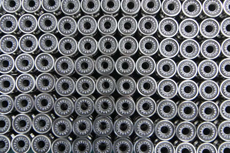 Close up on ball bearings lined up.