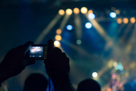 Concert photography during a gig, this is the point of view of the crowd in front of a stage during a music festival