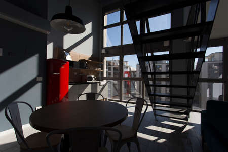 Interior shot of a modern loft flat, no people are visible.