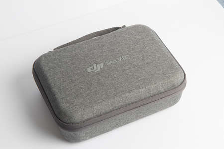 Milan, Italy - July 25, 2020: close up on a DJI Mavic Mini drone case resting on a white background, no people are visible. Editöryel