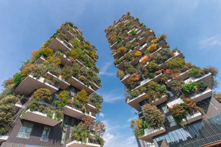 Milan, Italy - October 10, 2020: low angle view of the Bosco Verticale towers in Milan, shot is taken in full daylight and no people are visible. Editorial