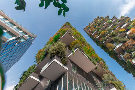 Milan, Italy - October 10, 2020: low angle view of the Bosco Verticale towers in Milan, shot is taken in full daylight and no people are visible.