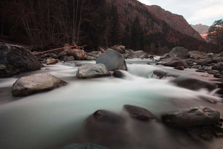 Long exposition shot of a river with silk effect on the water, while the rocks and background are sharp in focus. No people are visible. Stockfoto - 158124782