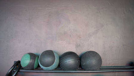 shelf with crossfit balls of different sizes