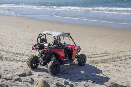 amazing all-terrain car for extreme sports parked on the beach at the seashore