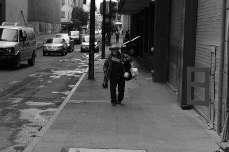 MEXICO CITY, MEXICO - September / 21 / 2018 old man walking accompanied by his violin