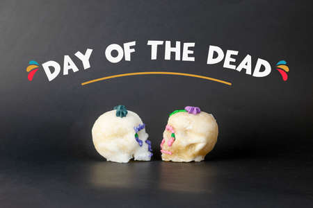 sugar skulls of the day of the dead with the phrase day of the dead Foto de archivo