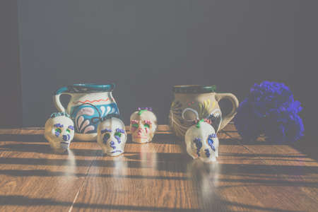 Mexican cups and sugar skulls as decoration for the day of the dead, Mexican holiday
