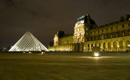 PARIS - MARCH 20: Louvre Pyramid shines at night during the winter March 20, 2008 in Paris. Louvre is the biggest Museum in Paris displaying over 60,000 square meters of exhibition space. Stock Photo - 10950128