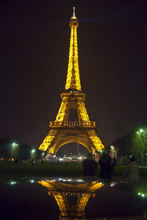 PARIS - MARCH 20: Eiffel tower at night on March 20, 2008 in Paris. The Eiffel tower is the most visited monument of France and the most recognizable landmark of the world. Stock Photo - 10950131