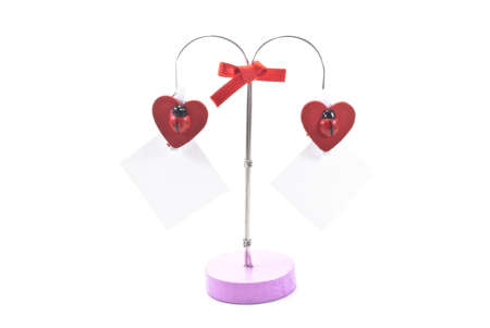 red hearts and a slip of paper on a clothes pin on white background photo