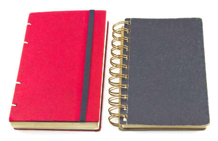 black and red notebooks closed isolated over white. Book for taking notes photo