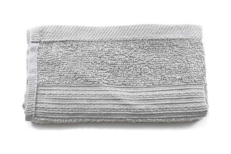 Crumpled grey cloth(rag) isolated on white background photo