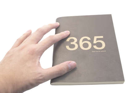 omnipresent: The golden phrase 365 days can be special done in cover on a dark paper background of a book
