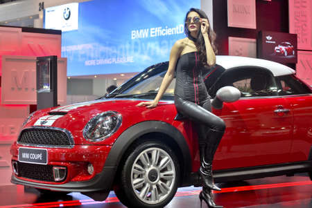 BANGKOK - DECEMBER 3: Female presenters model at the Mini booth during Bangkok International Motor Show at Impact Challenger on December 3, 2011 in Bangkok, Thailand. Stock Photo - 11691541