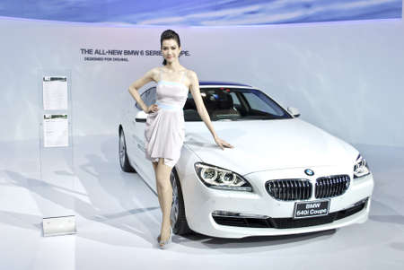 BANGKOK - DECEMBER 3: Female presenters model at the BMW booth during Bangkok International Motor Show at Impact Challenger on December 3, 2011 in Bangkok, Thailand. Editorial