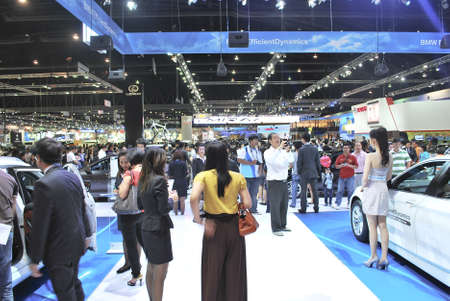 BANGKOK - DECEMBER 3: Nissans booth with crowded people at Motor Expo, Impact on December 3, 2011 in Bangkok, Thailand.