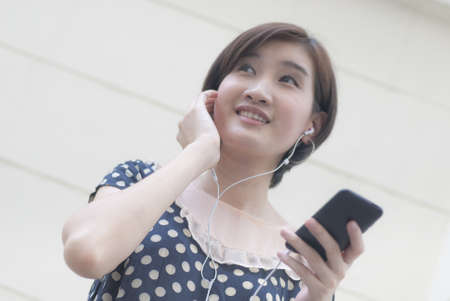 a portrait of beautiful woman listening to music Stock Photo - 11703241