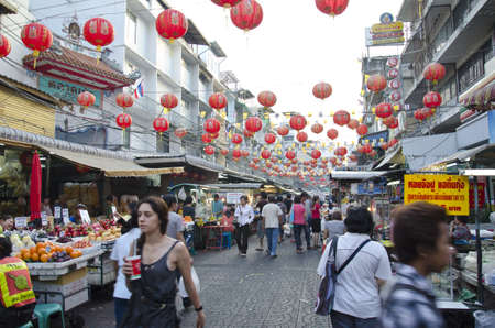 BANGKOK - December 30: Red lanterns and decorations span Yaowarat Road in Bangkok