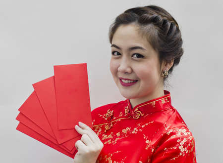 pretty chinese young woman holding red bags for happy chinese new year Stock Photo