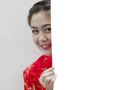 Oriental girl wishing you a happy chinese new year, with copy space. Stock Photo - 11890704