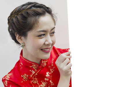 Oriental girl wishing you a happy chinese new year, with copy space. Stock Photo - 11890706