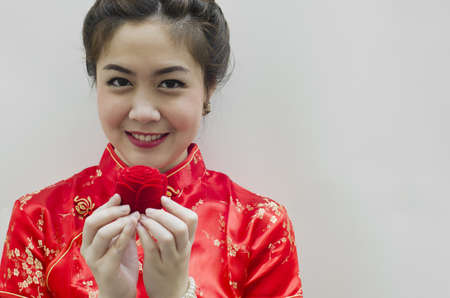 smiling beautiful chinese woman holding the rose photo