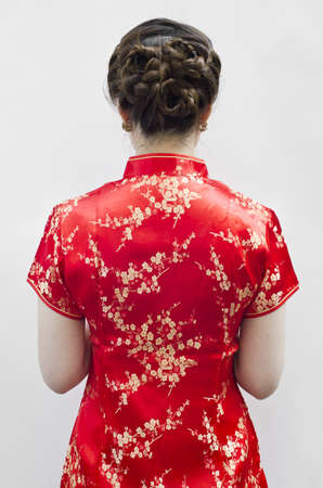 Oriental Cheongsam or mandarin gown, is formal wear for important occasions. Red is lucky color of Chinese, red cheongsam usually wear by during new year day or wedding. photo