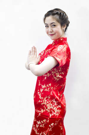 happy Chinese new year. beautiful young Asian woman with gesture of congratulation photo