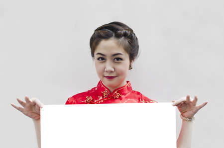 Oriental girl wishing you a happy chinese new year, with copy space. photo