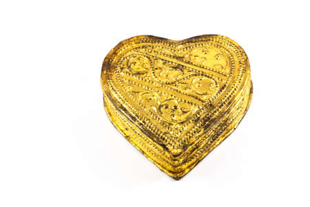 angel alone: Golden heart on a white background, isolated Stock Photo
