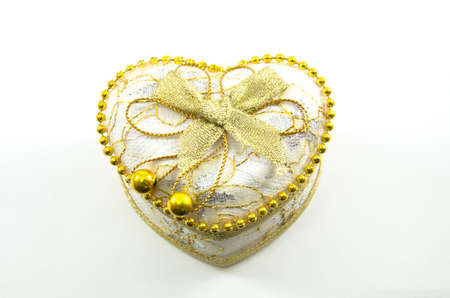 angel alone: Golden heart on a white background,isolated
