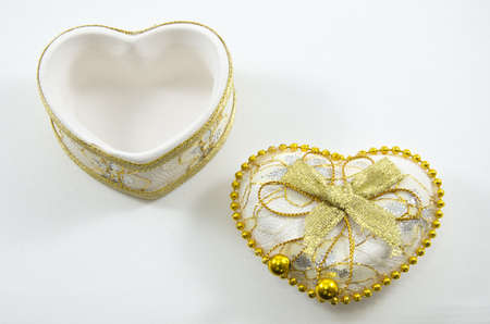 Golden heart on a white background,isolated photo