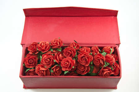 a bunch of red roses in red box isolated on white background