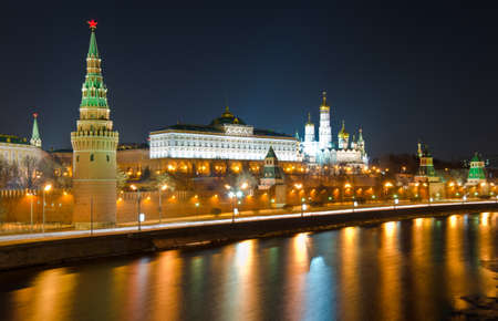 moscow churches: Kind to the Moscow Kremlin and Moskva River in winter night  Russia