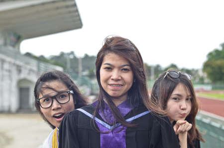 Portrait of Asian female graduate in Thailand photo