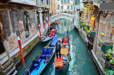 typical urban view with canal, boats and houses in Venice - Italy