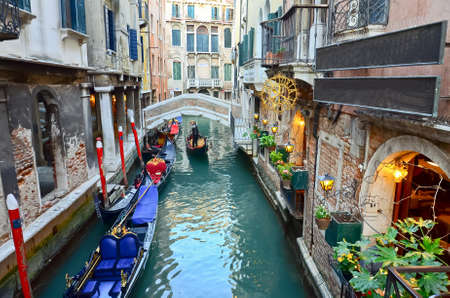 typical urban view with canal, boats and houses in Venice - Italy Editorial