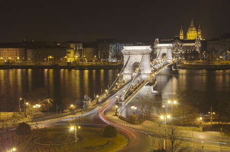 HDR View of Chain Bridge and St. Stephens Basilica at night.Budapest, Hungary photo